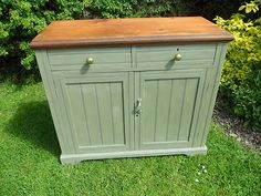 """Country kitchen dresser base, server would look great for a country kitchen.The dresser has two drawers with brass knobs and a large double door cupboard beneath.The dresser has been painted in ANNIE SLOAN CHALK PAINT """"CHATEAU GREY """" which is a lovely colour , it has then been waxed in ANNIE SLOAN clear soft wax giving it a lovely finish .The dresser has then been gently distressed,the top has been left in its original state but did receive a light sand prior to waxing for a hard wearing…"""