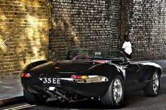 Jaguar E-type:  Just love those dual exhaust pipes. Arguably one of the 5 most beautiful cars that were ever built.