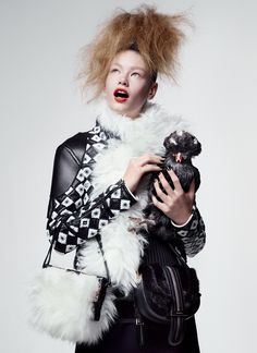 Puff Piece - Face-framing fur trim delivers a touch of Hollywood drama. Model Hollie-May Saker (here with a Polish chicken) wears a Louis Vuitton leather jacket with shearling collar, knit top, double-buckle miniskirt, and white sheepskin bag; select Louis Vuitton boutiques. Salvatore Ferragamo mink-and-suede cross-body bag.  Beauty Note  Sisley Phyto-Lèvres Perfect Lip Pencil delivers a precise application—no lipstick required—for a flawless matte mouth.