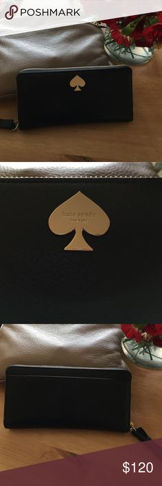Kate Spade Leather Wallet Cute Kate Spade black leather wallet. Excellent, like new condition. Comes with care card. 12 card slots. kate spade Bags Wallets