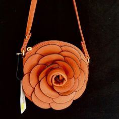 Buona Brown Flower Cross Body Purse Gorgeous! Faux leather, two removable straps - short & long. 7x7. 🔹Please ask all your questions before you purchase! I am happy to help! 🔹Sorry, no trades. 🔹Please, no lowball offers. 🔹Happy Poshing! Buona Bags Crossbody Bags