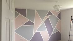 Geometric painted wall using frog tape and valspar paint pink grey purple