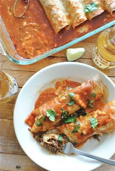 Slow Cooker Shredded Beef Enchiladas....another pinner said these were hands down the best meal her boyfriend ever ate.