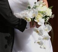 Classic white bridal bouquet with orchids, roses and lily of the valley