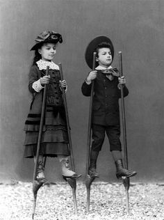 Stilt-walking kids.