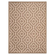 Suitable for both indoors and out, this power-loomed rug features a honeycomb quatrefoil pattern in brown tones. Team with a wooden bench and coloured glass ...