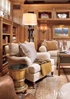 An A. Rudin sofa and chair, purchased through Dean-Warren, form a cozy vignette for reading in the library, lit from above an antique wall sconce and an Allan Knight bronze floor lamp with a champagne shade. A Saxony antelope rug grounds the space.