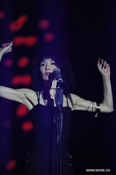 Hong Kong film star Maggie Cheung performs during the 2014 Strawberry Music Festival in Shanghai, China, May 1, 2014. The festival runs May 1-3