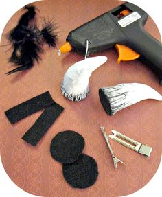 Horn Hair Clip project:  1 package of FIMO air for the microwave Basic sculpting tools Black, white and silver acrylic craft paint Craft paint brushes (Soft or stiff bristle will both work, use what you have.) Hot glue gun and glue sticks Black maribo or the soft fuzzy part of a black feather Two old style curler clips (see pictures below) Black felt Scissors microwave small tub of water