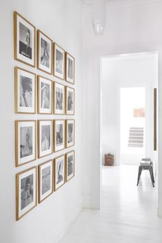 white room, light wood frames, black-and-white photos • Justine Hugh-Jones' home • via Est Magazine