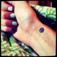 peace - i live with this permanently drawn on my wrist