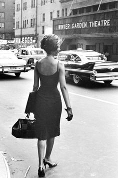 New York, 1960   - HarpersBAZAAR.com  Love this bag, too! I miss gloves being worn.