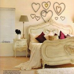 Such a romantic looking bedroom! Love the hearts above the bed.