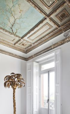 Painting ceiling with beautiful millwork and gold palm tree, design by Beatriz Silveira