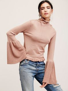 Ruffle Fan Pullover | Comfy knit pullover featuring a drapey turtleneck with lovely exposed button details. Ruffled hem and dramatic bell shaped…