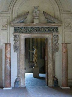 Doorway inside the Palazzo Altemps, or The National Roman Museum in Rome, Italy. It's a 15th-century palace housing Renaissance artworks & antiquities, Greek & Roman sculptures & library.