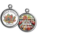 """Two sided charm or pendant with """"inhale, exhale, repeat"""" and """"strive for progress not perfection"""". Vintage collage art with a lily. Wear alone or combine with more charms to create an individualized gift for a graduate, friend or family! $13.99 by Pick Up Sticks Jewelry"""