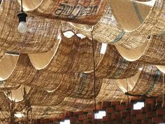 using burlap to cover tent ceiling Fabric Ceiling, Ceiling Draping, Wall Drapes, Ceiling Canopy, Valance Curtains, Outdoor Cafe, Outdoor Restaurant, Restaurant Restaurant, Funky Junk Interiors