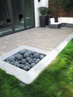 Contemporary Living- pavers, pebbles & grass - Shades of Green Landscaping