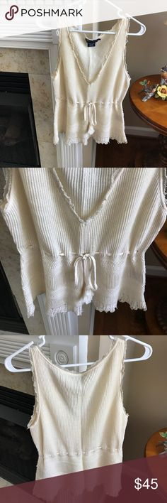 Cream Ralph Lauren V Neck Sweater Top Cream Ralph Lauren V Neck Crocheted Sweater Top. Sleeveless. Gathers with Tassle Tie. 55% Linen 44% Cotton. Size Large. Great Used Condition. Bought with Cream RL Blazer in my closet. Ralph Lauren Tops