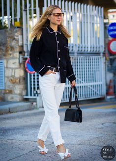 Pernille Teisbaek wears a pajama blouse, belted white jeans, top-handle bag,  and bow detail mules dcc5bb9dc0b2