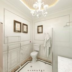 Chrome accessories and faucets emphasize a silver A frieze on the walls is the highlight of the space. Faucets, Highlight, Chrome, Art Deco, Bathtub, Walls, Space, Silver, Accessories