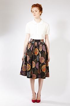 Fall weather is no excuse to dial down the glamour; this full, pleated skirt will keep the windy weather out and eyes on you. The...