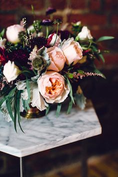 Lush florals in a rich colour palette of peach and deep purple
