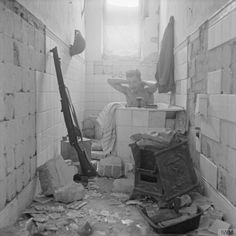 A British soldier takes advantage of the opportunity to have a bath in Tobruk, Libya. 17th February 1942.