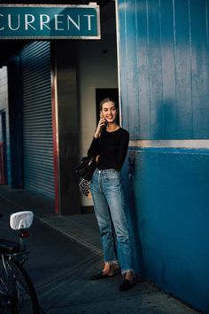 A black body-con sweater will always be the perfect partner to vintage straight-leg jeans.