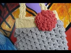 This is part 4 of 5 of the Mermaid Tears Purse. Mikey, from The Crochet Crowd, will guide you through the flower applique and will begin the process of crocheting up the bottom seam of the purse. You will find the written pattern at  http://www.bernat.com/pattern.php?PID=6267    Welcome: Michael Sellick aka Mikey. Many patterns as seen on our YouTu...