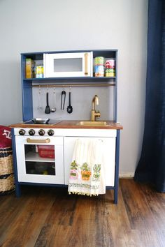 Super simple IKEA hack - making the DUKTIG play kitchen prettier with a little paint and creativity! // Love & Renovations