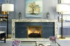 Glass tile and marble fireplace . . . VERY elongated shape, I like this concept... so chic.