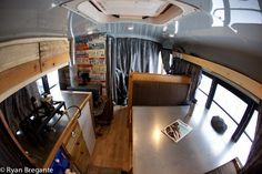 Short school bus 4x4 converted to snowmobile hauler and snowboarders den with shower, toilet, woodstove, the works.