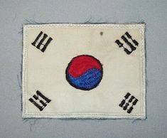 """This offering is for an old vintage US Army Soldiers Soldiers Korean Flag Shoulder Patch. The patch belonged to a soldier who served from 1970 to 1971 on the DMZ area in Korea and it appears to be theater made . The patch measures 2 7/8"""" by 2¼ and it has been used but is still nice."""