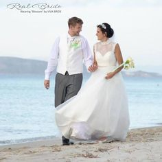 What a beautiful photo of real bride Sonya wearing 'Blossom' by Viva Bride  She looks so perfect walking along the beach in this romantic dress!  Could this be 'the one' for you? www.wed2b.co.uk