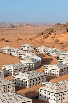 Tented camp Libyan Sahara. The luxurious tents each have their own porch and are positioned in a semi-circle in this spectacular desert landscape.
