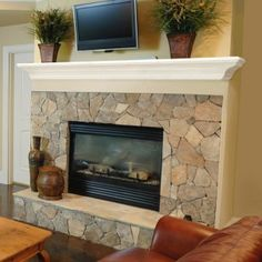 Use the fireplace mantle as the top of a headboard...possibly a DIY fabric headboard underneath...
