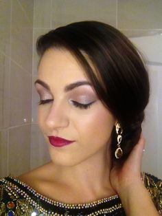 Gatsby inspired. Smokey brown eye & Cranberry lip.  Eyes using urban decay naked 2 palette, Bootycall (base) suspect (lid) foxy (brow bone) blackout (crease,edge) Maxfactor masterpiece mascara, Rimmel kohl eyeliner in jet black, Rimmel scandaleyes precision liner.  lips urban decay lip liner in venom, lipstick in shame.  Other products used, Face, Buff HD foundation in C35, Mac Mineralize Skinfinish, no7 perfect match skin foundation, Bobby Brown blusher in pale pink.