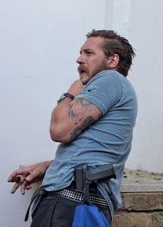 Wow! Tom Hardy with a cigar, a gun and a beard