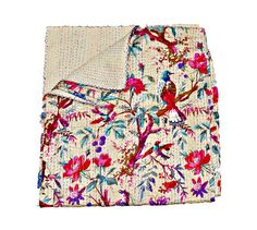 Give your home a traditional yet authentic colorful look with this beautiful kantha quilt blanket or throw which can also be used as handmade tropical Kantha bedspread bedding. This is completely hand quilted blanket made from cotton. A feast for the eyes from South Asia, this delightful piece will add some exotic flair to your living space.