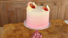 Recipe with video instructions: How beautiful is this cake? Ingredients: Cake:, 250g butter, 250g caster sugar, 250g self raising flour, 200g (4) eggs, Vanilla Extract, Buttercream:, 500g icing sugar, 150g softened butter, 60ml milk, 1 Vanilla pod, Pink Food colouring, Decoration (optional):, Fresh Fruit, Macarons, Meringue Kisses, Glitter + Gold dust