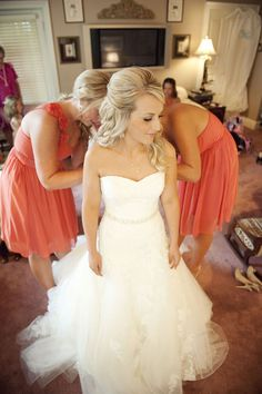 I can already see this photo being taken on my wedding day! The beautiful coral dresses on my gorgeous bridesmaids as they help me into my dream dress, before I walk down the aisle into my dream life.