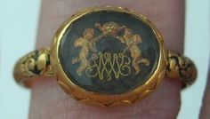 """Gold mourning ring or """"Memento Mori"""".....ca. 1680....with two cherubs holding a skull with hairwork beneath"""