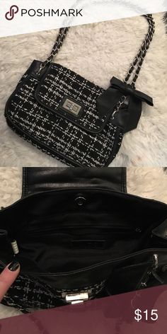 Aldo Tweed chain purse Cute as can be tweed purse. Black and white tweed with black faux leather trim. Silver hardware and link chain straps with black faux leather. Removable black faux leather bow. Great condition! Aldo Bags Shoulder Bags