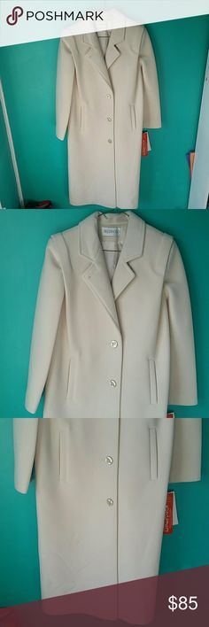 Brand New Sherwood Long Coat Size 10P This gorgeous coat is brand new with tags. It's in great condition. Brand name is Sherwood and it's a size 10 Petite. Color is a off white or cream color. Buttons down in the front and it has pockets. This jacket is washable. The shell and the lining is 100% polyester. If you have any questions please let me know. Feel free to make an offer! Sherwood Jackets & Coats