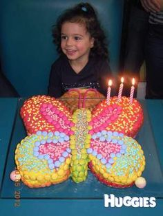I made a chocolete butterfly cake for my daughter's 3rd birthday.