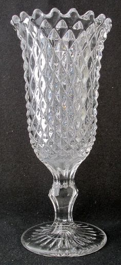 "EAPG ""SAWTOOTH"" pattern footed Celery vase made by the New England Glass Co. of soda lime glass, circa 1865-1900, 9.75""H x 4.25""D."