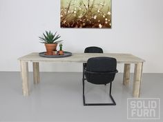 """Watch this reclaimed look dining table """"Columbus"""". Are you looking for a solid, heavy dining table that can take a good knock? The immensely popular """"Columbus"""", made with reclaimed look pinewood, comes with slightly narrower, (but nevertheless thick) legs, as you can see here in the photo. Because we work with reclaimed look pinewood, you can clearly see the grain and knots in the wood that really makes the tabletop attractive."""