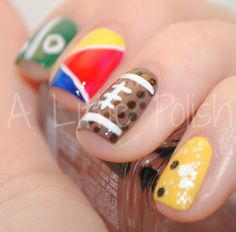 I love the football nail...maybe the rest of nails can be school colors or team colors..Too cute